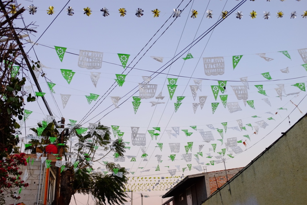 Paper garlands against a twilit sky